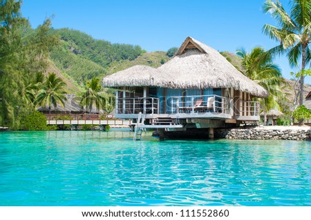Luxury over water bungalow in green lagoon. Tahiti