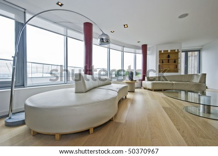 luxury penthouse living room with massive leather sofas #50370967