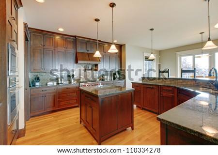 Luxury pine wood beautiful custom kitchen interior design with island and granite.
