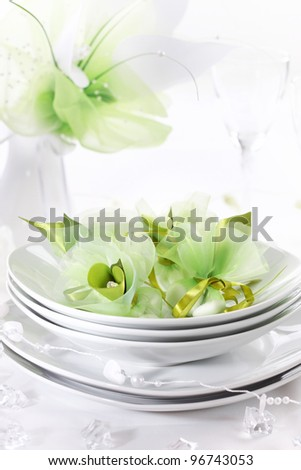 Luxury place setting for wedding in white and green tone