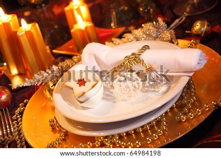 Luxury place setting in golden and white  for Christmas