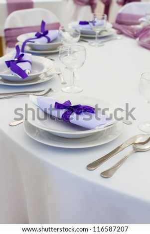 luxury place setting, purple napkin on plate