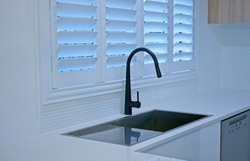 Luxury plantation shutters in a modern kitchen