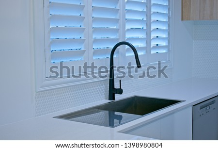 Luxury plantation shutters in a modern kitchen Stock photo ©