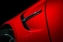 Luxury red car details view, elegant and beautiful