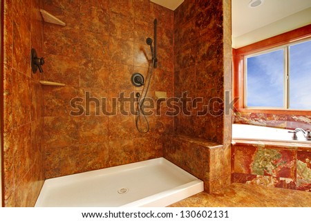 Luxury red marble bathroom  with shower in a New luxury home interior.