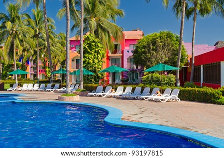 Luxury resort with nice pool and beautiful building view.