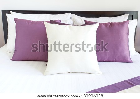 Luxury room setting with bed and pillows