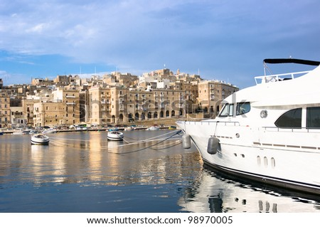 luxury sailboat moored in Senglea Marina, on background  Valletta - Malta