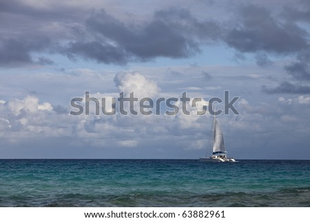 Luxury sailboat on blue lagoon of a tropical island