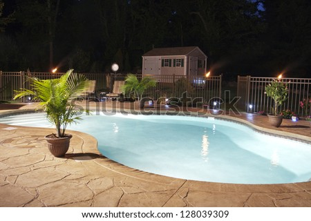 Luxury Salt Water Pool And Patio At Night.
