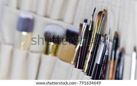 Luxury set of different brushes. Beauty background. Close up concept. Decorative natural cosmetics. Make-up artist set. Work paint art. #791634649