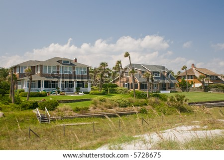 luxury, shake exterior beach front homes with tropical landscaping