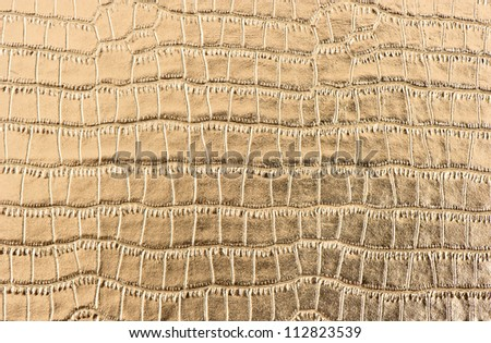 luxury shiny golden crocodile leather background