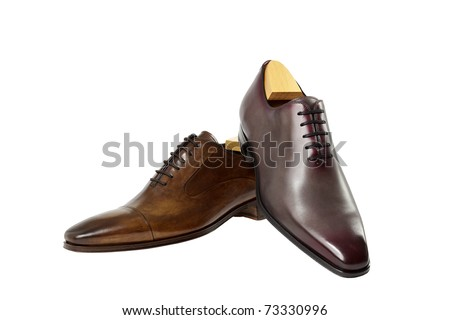 Luxury shoes on white background. Not the same pair - stock photo