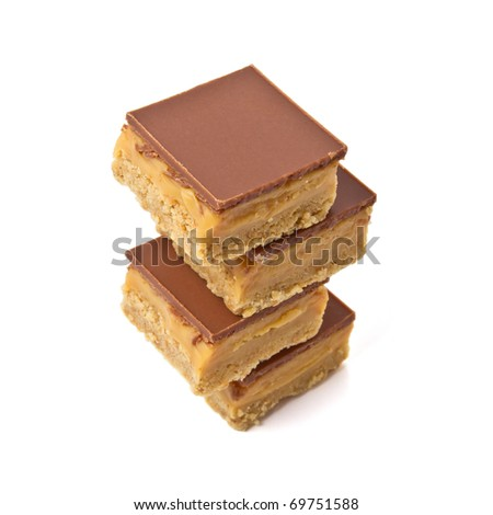 Luxury Shortbread called millionaires shortbread isolated on white.
