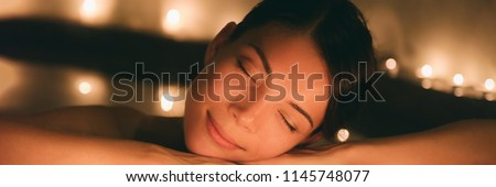Luxury spa massage woman. Pampering whirlpool jacuzzi lifestyle girl relaxing in hot water banner panorama. #1145748077