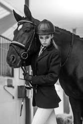 Luxury sport. Photo in equides club. Perfect model and hourse. Indoor shot, sport and fashion concept.