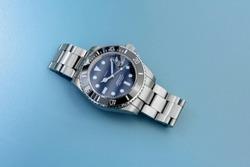 Luxury sport stainless steel divers watch  on light blue background