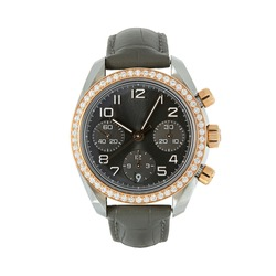 Luxury steel watch with rose gold and diamonds and with a black strap, front view isolated on white background