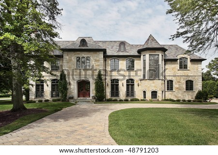 Luxury Stone Home In Suburbs With Turret Stock Photo