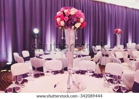 Luxury stylish wedding reception purple decorations expensive hall lights and flowers