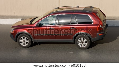 luxury suv car isolated on road. See many similar quality images in my portfolio