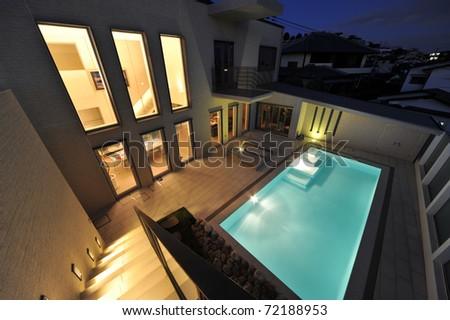 Luxury swimming pool and villa at night