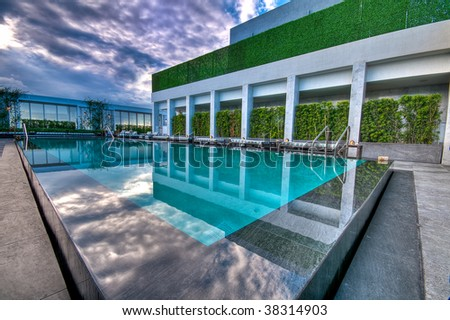 stock photo luxury swimming pool at luxury hotel 38314903 Luxury Swimming Pools