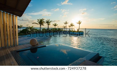 Luxury swimming pool near beach front #724937278