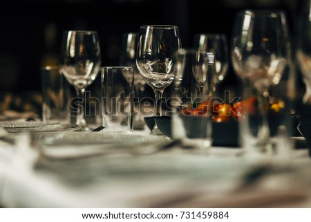 Luxury table settings for fine dining with and glassware, beautiful blurred  background. Preparation for holiday  Christmas and Hannukah dinner night. #731459884