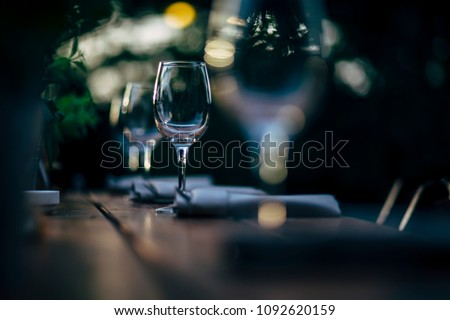 Luxury table settings for fine dining with and glassware, beautiful blurred  background. For events, weddings and other social events. #1092620159
