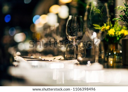 Luxury table settings for fine dining with and glassware, beautiful blurred  background. For events, weddings.