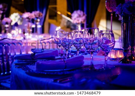 Luxury table settings for fine dining with and glassware, beautiful blurred  background. For events, weddings.  Preparation for holiday props for weddings, birthdays, and celebrations, blur #1473468479