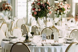 Luxury table with the bouquet of flowers