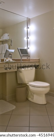 Luxury toilet with TV set mirror and towels