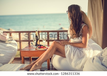 Luxury travel. Summer holiday girl enjoying vacation  #1286311336