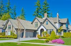 Luxury triple garage doors home in the suburbs of  North America