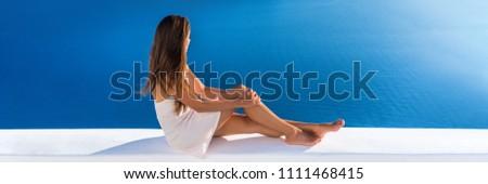 Luxury vacation woman enjoying fancy resort balcony, cruise ship Mediterranean sea destination. Elegant lady at serene ocean landscape background banner panoramic view.