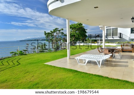Luxury villa balcony with seascape view and table with chairs