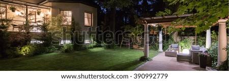 Luxury villa with patio in garden at night