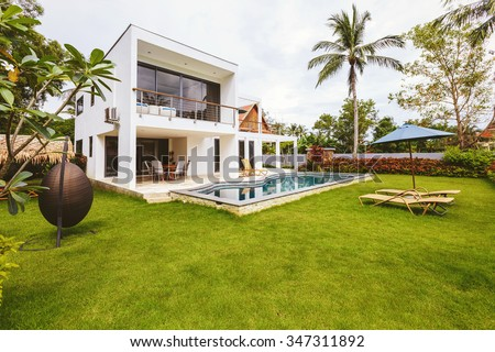Luxury villa with swimming pool outside exterior view