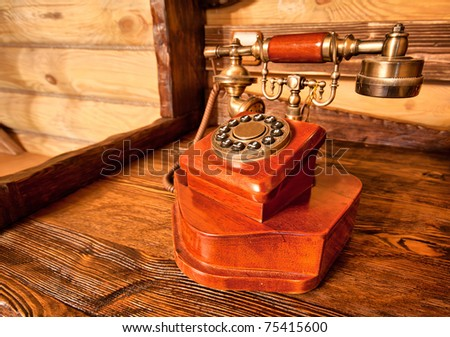 Luxury vintage interior - wooden telephone on the table
