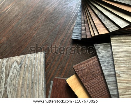 Luxury Vinyl floor tile or rubber flooring sample stack for interior design idea #1107673826