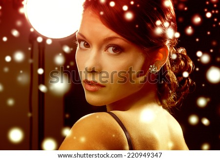 luxury, vip, nightlife, party, christmas, x-mas, new year\'s eve concept - beautiful woman in evening dress wearing diamond earrings