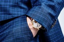 Luxury watch worn on male wrist. Elegant timepiece. Observing punctuality.