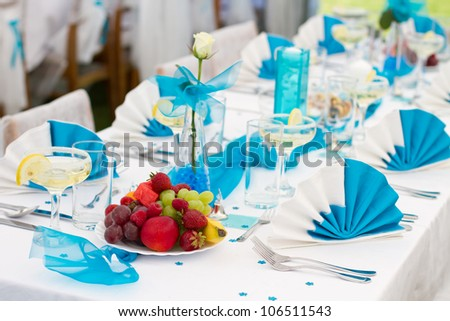 Luxury wedding lunch table setting outdoors, in white-blue colors