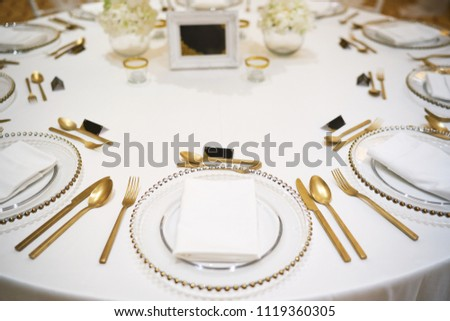 Luxury wedding reception dinner table setup with copper fork and spoon set