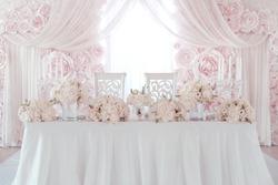 luxury wedding table with beautiful flowers.  pink stylized