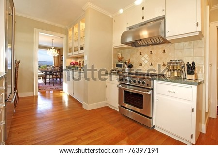 Luxury white antique kitchen with oak floor and cream soft colors.